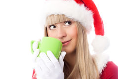 Menina sonhadora que come um copo do chá Fotos de Stock Royalty Free