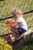 Menina sozinho na caixa de areia Foto de Stock Royalty Free