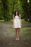 Menina sozinho na madeira Imagens de Stock Royalty Free