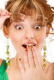 A menina surpreendida cobre a boca com a palma Imagem de Stock Royalty Free