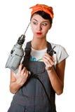 Menina surpreendida com ferramentas Imagens de Stock