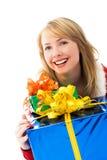 Menina surpreendida com muitos presentes Foto de Stock
