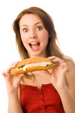 Menina surpreendida com um hot-dog Imagem de Stock Royalty Free