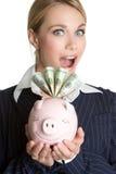 Menina surpreendida de Piggybank Foto de Stock