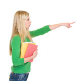 Menina surpreendida do estudante que aponta no espaço da cópia Foto de Stock Royalty Free