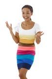 Menina surpreendida feliz no vestido multicolour fotografia de stock