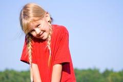Menina tímida nas tranças. Fotos de Stock