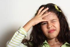 A menina tem uma dor principal Imagem de Stock