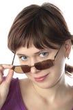 A menina tenta vidros de sol Imagens de Stock
