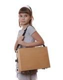 A menina tira uma pintura na armação no fundo branco Fotografia de Stock Royalty Free