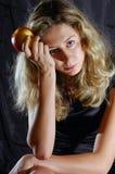 Menina Tired com uma maçã Foto de Stock