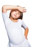 Menina tired pequena do dançarino no branco isolado Imagens de Stock Royalty Free