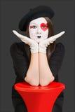 Menina triste com máscara do palhaço fotografia de stock royalty free