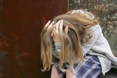 Menina triste comprimida Imagem de Stock