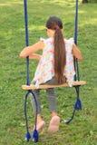 Menina triste no balanço Foto de Stock Royalty Free