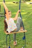 Menina triste no balanço Imagem de Stock