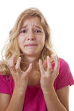 Menina triste no desespero sobre o fundo branco Fotografia de Stock