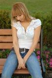 Menina triste no parque Foto de Stock Royalty Free