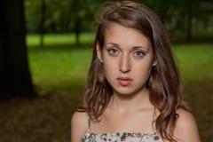 Menina triste no parque Fotografia de Stock