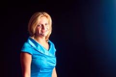 A menina um vestido azul Imagem de Stock