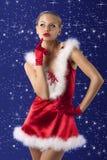Menina vermelha e 'sexy' de Papai Noel imagem de stock
