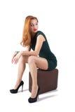 Menina vermelha no vestido verde Imagem de Stock Royalty Free