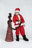 Menina vestida como Papai Noel com Natal Imagens de Stock