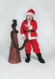 Menina vestida como Papai Noel com Natal Imagem de Stock