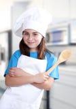 Menina vestida como um cozinheiro Fotografia de Stock Royalty Free