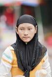 Menina vestida tradicional nova da minoria de Hui, Hainan, China Imagem de Stock