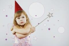Menina virada com a vara mágica de prata no estúdio Imagens de Stock Royalty Free