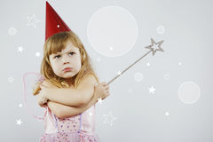 Menina virada que levanta com a vara mágica de prata Fotos de Stock