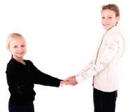 2 meninas adolescentes em um fundo branco Fotos de Stock Royalty Free