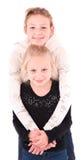 2 meninas adolescentes em um fundo branco Fotografia de Stock Royalty Free