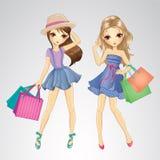 Meninas bonitos com sacos de compra Fotos de Stock Royalty Free