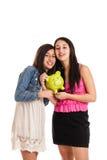 Meninas com banco piggy Imagens de Stock Royalty Free