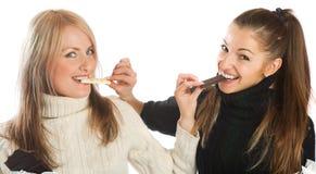 Meninas com chocolate Fotografia de Stock