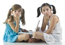 Meninas com computador fotografia de stock