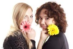 Meninas com flores Fotografia de Stock Royalty Free