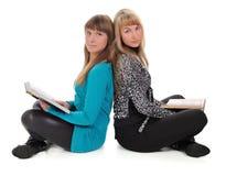 Meninas com livros imagem de stock