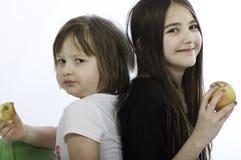 Meninas com maçã Foto de Stock