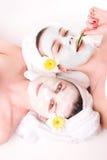 Meninas com máscaraes protectoras sobre Imagem de Stock Royalty Free
