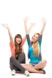 Meninas com os braços levantados Fotografia de Stock