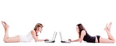 Meninas com portáteis Imagem de Stock Royalty Free