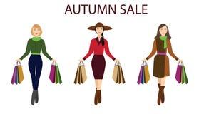 Meninas com sacos de compras, venda do outono Fotografia de Stock