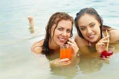 Meninas com suco Imagens de Stock