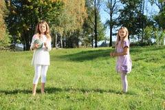 Meninas com uma bola Foto de Stock Royalty Free