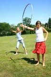 Meninas da aro de Hula Imagens de Stock Royalty Free
