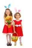 Meninas da beleza com orelhas e ovos da páscoa do coelho Fotografia de Stock