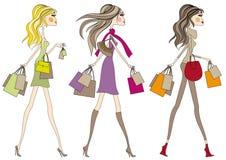 Meninas da forma com sacos de compra, vetor Fotografia de Stock Royalty Free
